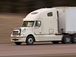 Photo of Class 8 Semi Truck driving at high speed